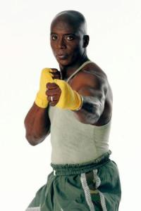 "Billy Blanks says ""Touch the controller; Get the PAIN!"""